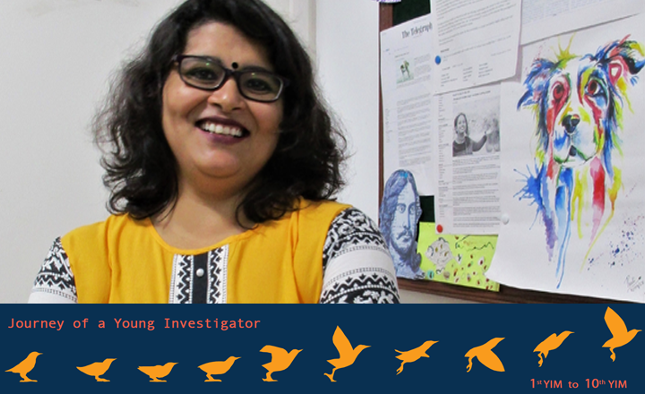 Anindita Bhadra in her lab, also called the Dog Lab. On the right, a painting of dog made by one of her students