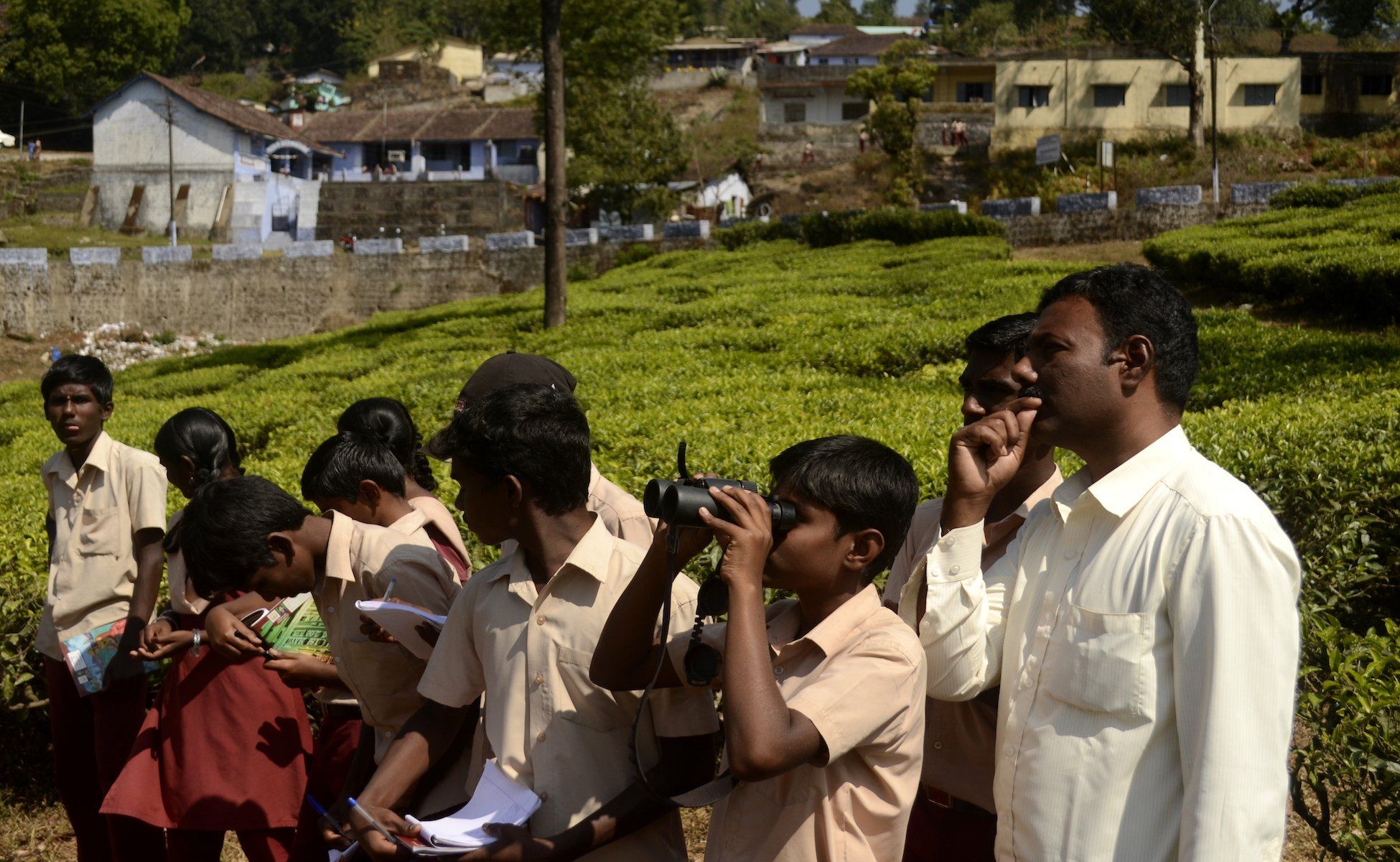 School kids watch birds on Anaimalai hills