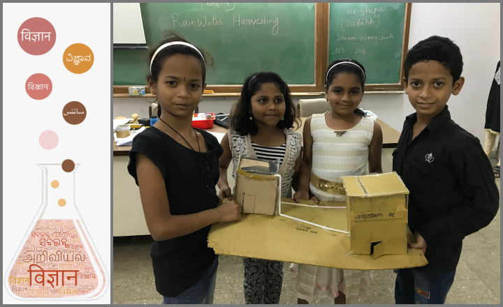 Students displaying their model of rainwater harvesting during a summer camp