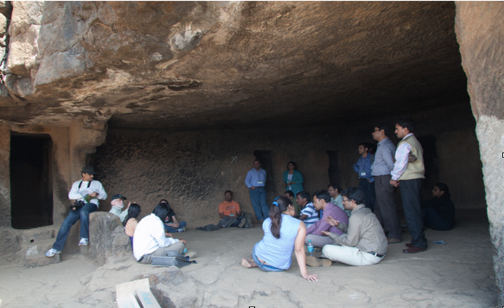 One of the small group mentoring sessions held in an ancient Buddhist cave with Nobel Laureate Mike Bishop leading the discussion (YIM 2012)